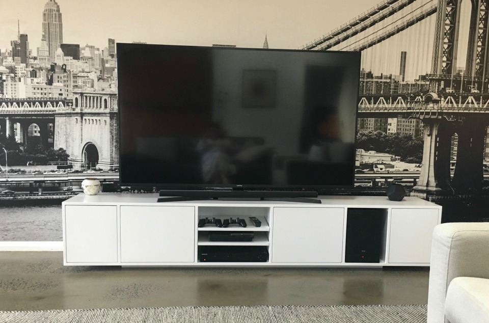 Entertainment Unit looking fabulous in front of a wall paper panel of the Brooklyn Bridge by Libby Gumley Geelong Interior Designer