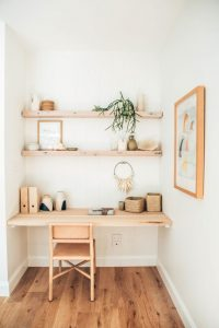 Image of a timber desk with shelving
